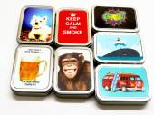 1oz tobacco tins - asstd designs.